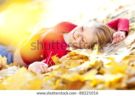 Happy smiling young woman portrait autumn outdoors