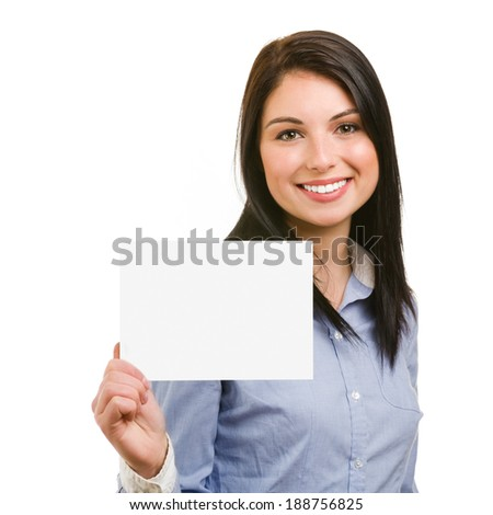 Happy smiling young woman showing blank signboard - stock photo