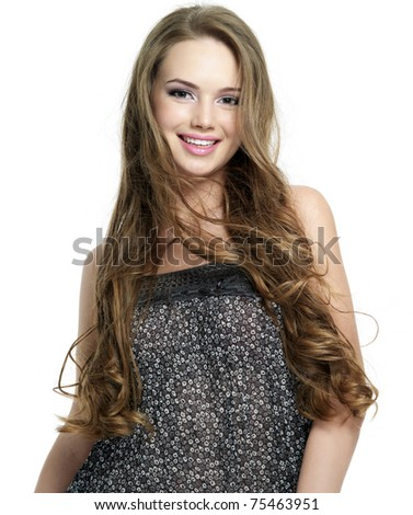 Happy smiling young woman with beautiful long hair - white background. Fashion model - stock photo