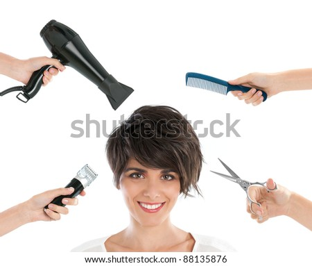 Happy smiling young woman with hairdresser tools among her isolated on white background - stock photo