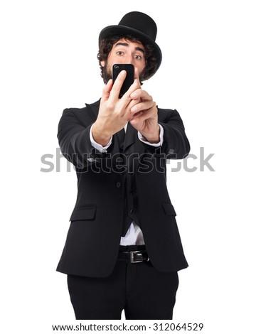 happy smoking man selfie pose - stock photo