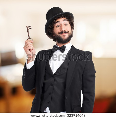 happy smoking man with vintage key - stock photo