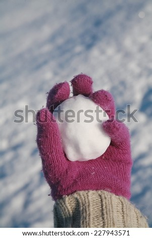 happy snow ball fight in winter time - stock photo