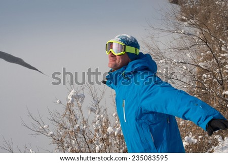 Happy snowboarder in winter flight - stock photo