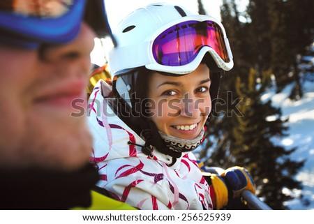 Happy snowboarding girls  - stock photo