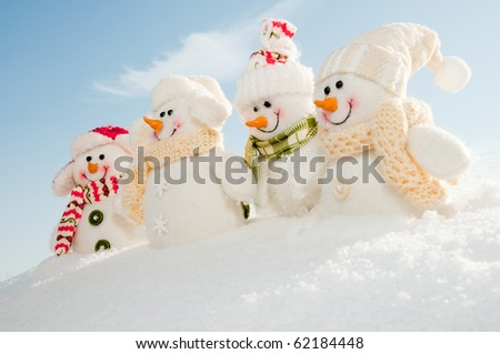 Happy snowman crew - stock photo
