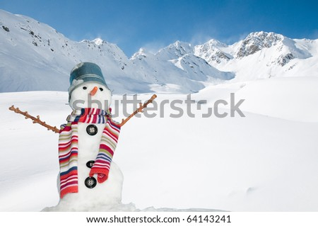 Happy snowman in mountains - stock photo