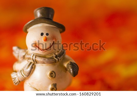 Happy snowman on red background - stock photo