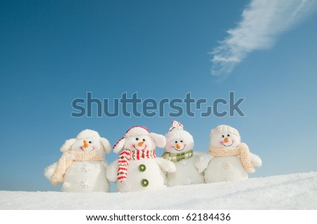Happy snowman team - stock photo