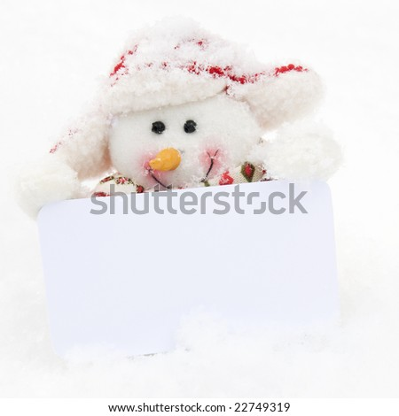 Happy snowman with white card on hands - stock photo
