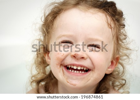 Happy soiled toddler in the bath - stock photo