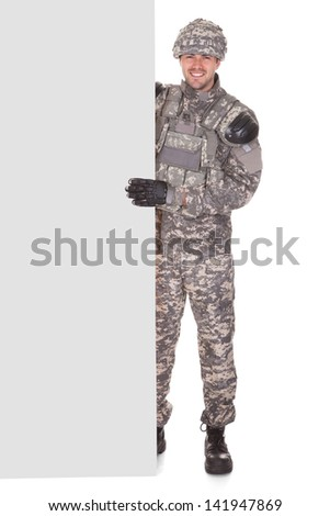 Happy Soldier Holding Placard Over White Background