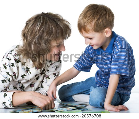 Happy son plays with mother - stock photo