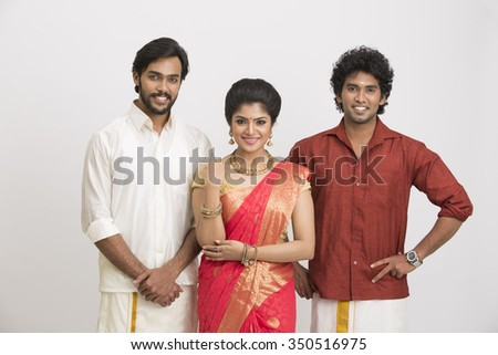 Happy South Indian traditional family gesturing on white background. - stock photo