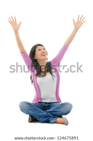Happy Southeast Asian Chinese woman arms opened looking up. Full body sitting on white background - stock photo