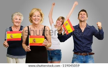 Happy Spanish Family Enjoying On Gray Background - stock photo