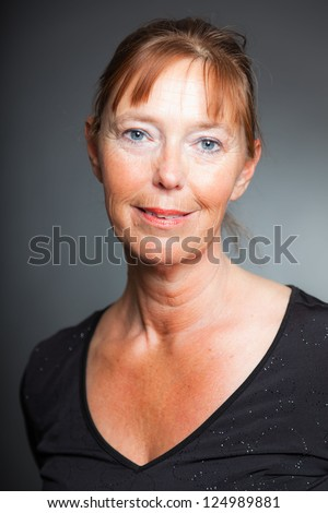 Happy spontaneous woman. Studio shot. - stock photo