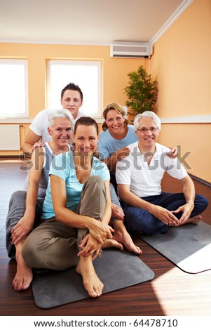 Happy sport class sitting in a gym - stock photo