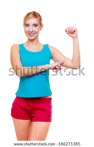 Happy sport young woman fitness girl showing her muscles. Power and energy concept. Isolated on white. Studio shot.