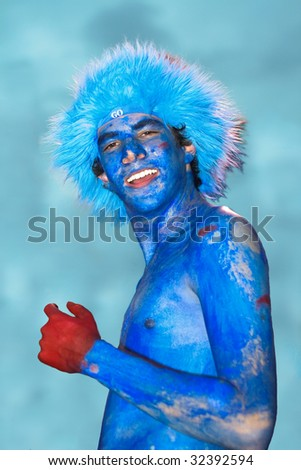 Happy Sports Fan on blurred background - stock photo