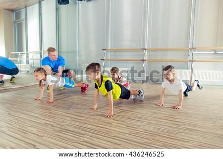 Happy sporty children in gym. - stock photo