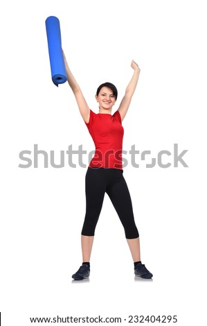 happy sporty girl with mat for fitness - stock photo