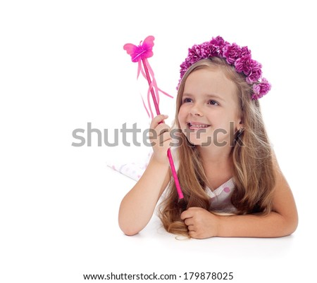 Happy spring fairy with purple flower crown and magic wand - isolated - stock photo