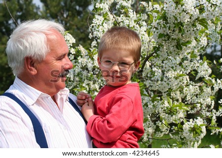 Happy spring with grandfather - stock photo