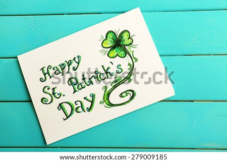Happy St Patrick's Day card on wooden background - stock photo