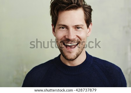 Happy stubble guy in blue, portrait