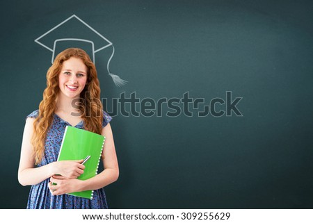 Happy student against teal, blue - stock photo