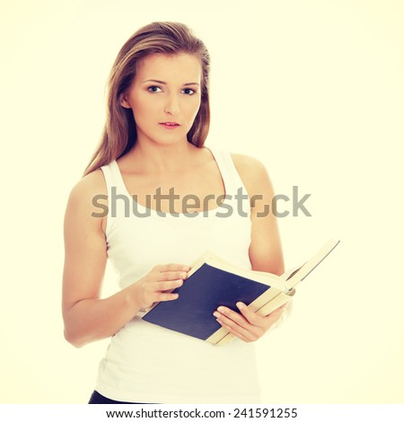 Happy student girl with book