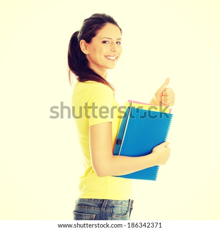 Happy student girl with thumb up - stock photo