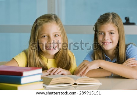 Happy student girls with books, studying - stock photo