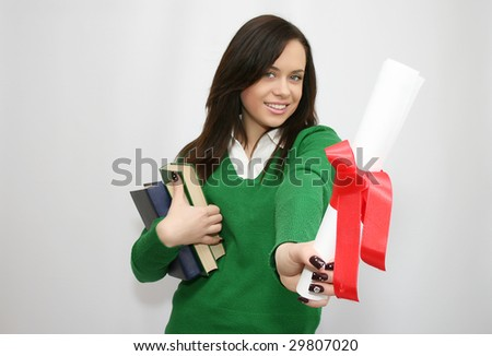 happy student holding a diploma - stock photo