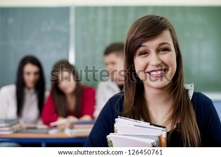 Happy student in the classroom - stock photo