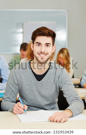 Happy student studying in an university class - stock photo