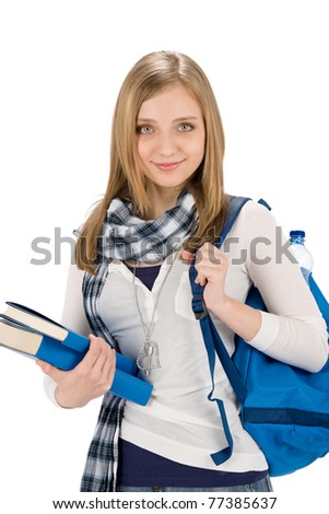 Happy student woman teenager with schoolbag hold books on white - stock photo