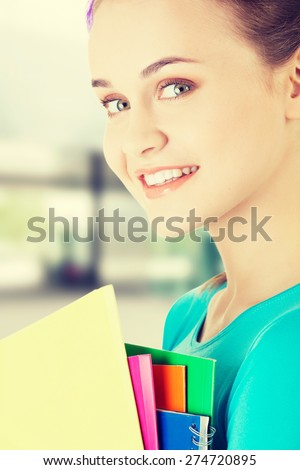 Happy student woman with notebooks - stock photo