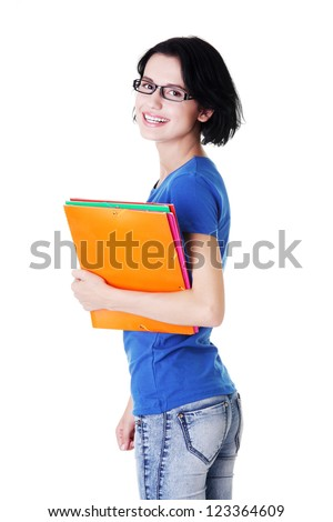 Happy student woman with notebooks, isoalted on white background - stock photo