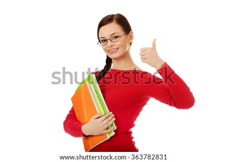 Happy student woman with thumb up - stock photo