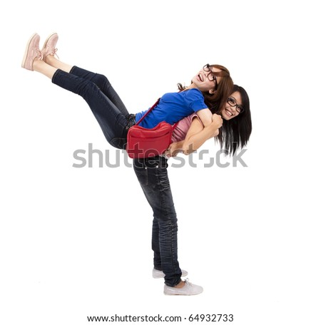 Happy students are playing together - stock photo