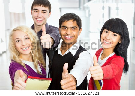Happy students giving the thumbs-up sign