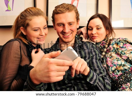 Happy students group demonstrating relaxation and friendship - stock photo