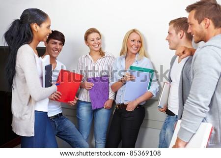 Happy students having a break in university hall - stock photo