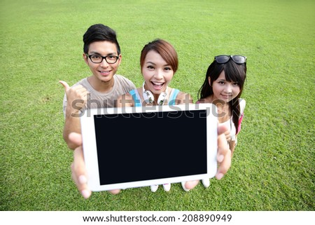 happy students in campus show digital tablet, asian - stock photo