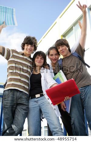 Happy students in school yard - stock photo