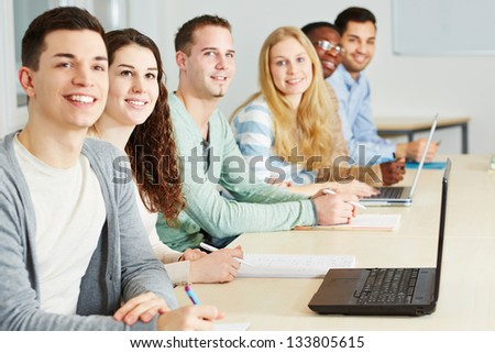 Happy students learning in seminar of an university - stock photo