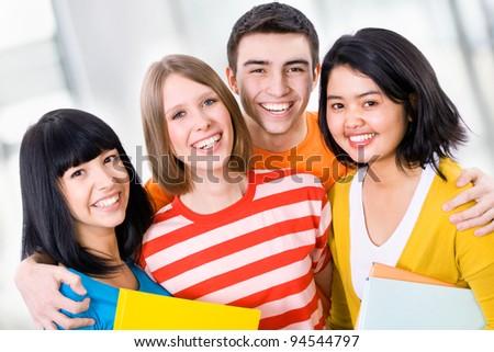 Happy students looking at camera - stock photo