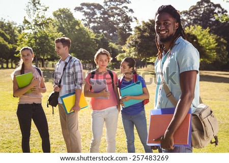 Happy students outside on campus on a sunny day - stock photo